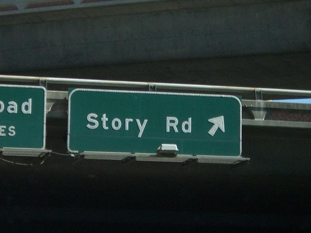 "A road sign that says ""story road"""